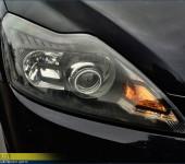 Установка биксеноновых линз и покраска внутренностей фар в черный матовый цвет на Форде Фокусе (Ford Focus)